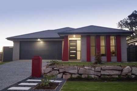 Stylish suburban house front at dusk
