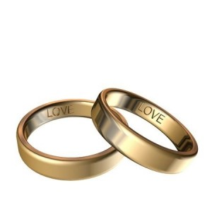 Golden rings with engraved love 3D rendering