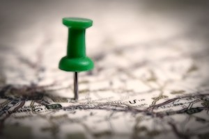 Thumbtack on a map symbol of travel destination