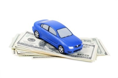 Toy car for dollar banknotes as background