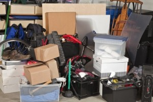 Pile of boxes junk inside a residential garage