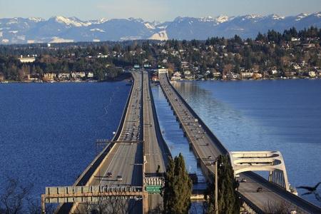 I-90 Bridge Seattle Mercer Island Highway Cars Snowy Cascade Mountains Bellevue Washington State Pacific Northwest
