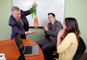 The great motivator dangling carrots and Business team motivated by positive presenter