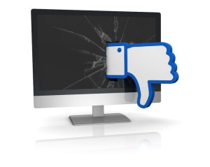 the thumbs down symbol of social networks that goes out from a computer screen (3d render)