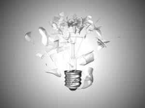 Bad idea. Crushed lightbulb over grey background
