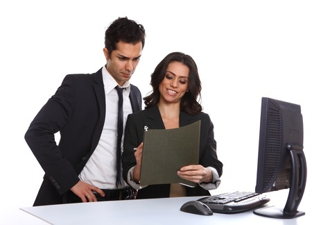 Business team looking over a file, isolated on white