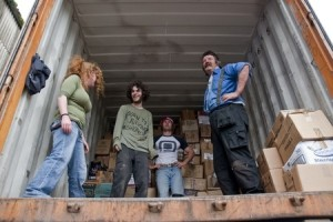 Volunteers from BookCycle stack boxes inside the container that is taking donated books to Ghana