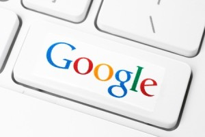 Keyboard with Google logotype, printed on paper and placed on button. Google is USA multinational corporation specializing in Internet-related services and products.