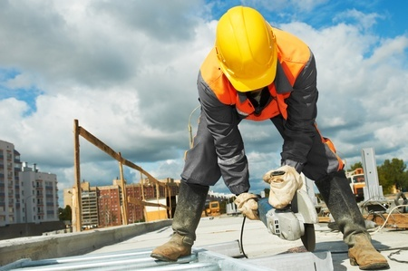 builder working with cutting grinder