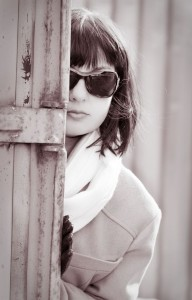 Mature woman in sunglasses watching someone. Retro style