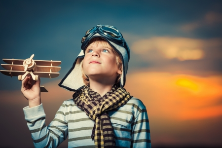 22349951 - boy with plane at sunset