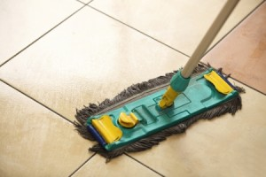 22578069 - cleaning the floor with a old mop, mopping