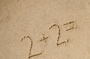 43072401 - hanwritten numbers on sand background
