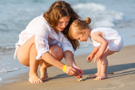 14346886 - mother with little daughter on the beach