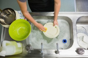 20517489 - overhead view of  hands washing a plate in the sink