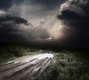 10676167 - muddy wet countryside road and dark storm clouds