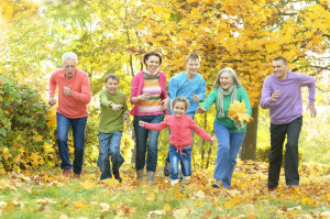 38863727 - happy smiling family relaxing in autumn park