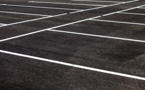 44929998 - white traffic markings on a gray asphalt parking lot