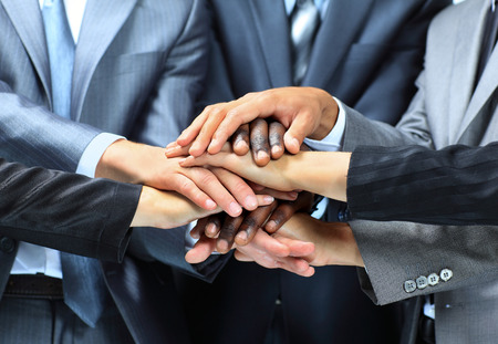 56767464 - closeup portrait of group of business people with hands together