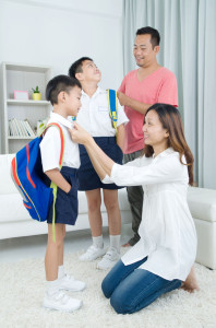 44148609 - asian parents get their children ready to school