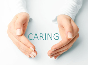39795353 - female hands with word caring on light background