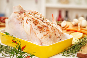 47836710 - preparing turkey  for christmas dinner