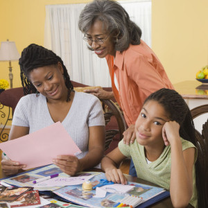 35789314 - african family making scrapbook together