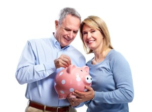 10857174 - couple with piggy bank.