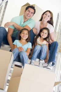 3487129 - family sitting on staircase with boxes in new home smiling