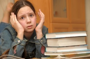 12387122 - the girl the teenager is upset by the big homework
