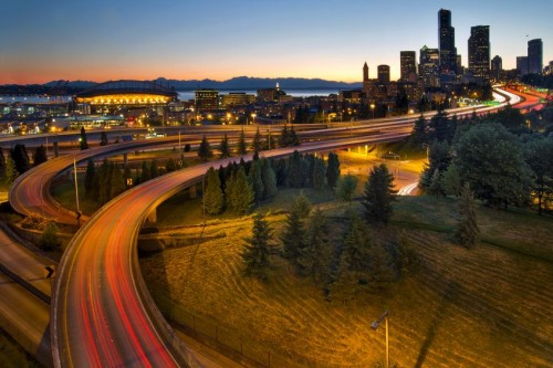 10726055 - seattle washington downtown city highway light trails at sunset
