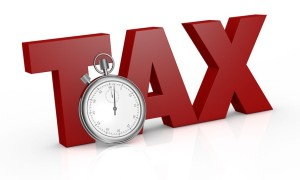 12519965 - the word tax with a stopwatch on front of it (3d render)