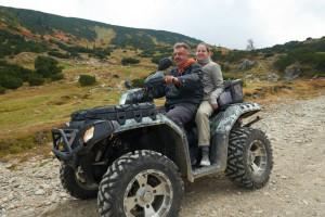 47766699 - couple drive atv quad bike in mountain nature