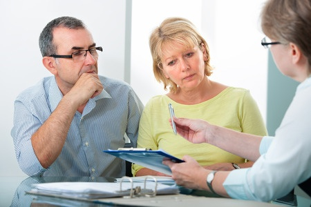 30500333 - mature couple getting financial advice from consultant at home