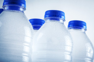 64786245 - wet plastic water bottles isolated on white background