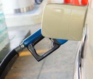 12397337 - putting gas in a car