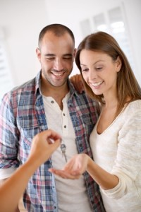 23148593 - cheerful couple getting keys of their new home