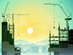 27751538 - a construction site with lots of tower cranes and sunset, sunrise