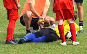 46619569 - injury on the soccer field, medic helps with a freezer spray