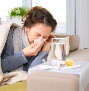 16443971 - sick woman flu woman caught cold  sneezing into tissue