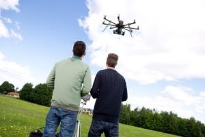 20198967 - 2 man playing multi rotor photography uav