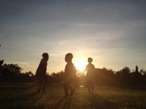 20584624 - kids playing outdoor during sunset