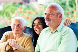 21830057 - smiling old man visiting her elderly mother in the nursing home.