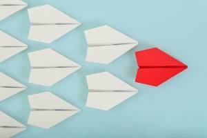 42303365 - red paper plane leading white ones, leadership concept