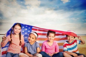 42360702 - children with american flag against serene beach landscape