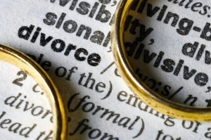 10361097 - two separate wedding rings next to the word divorce.