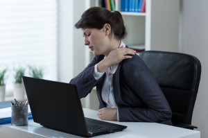38156472 - businesswoman leading sedentary lifestyle causing back pain