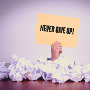 58960368 - hand holding yellow paper with never give up!concept