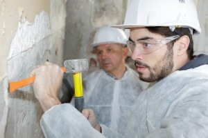 83134903 - worker scraping the wall