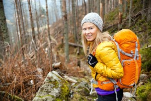 20439096 - woman hiking in autumn forest in mountains
